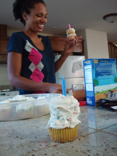 Jimaie doing some serious cupcake stacking